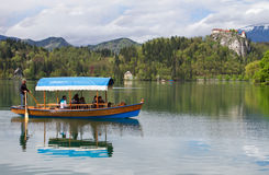 Tourists on boat at lake Bled Stock Photo