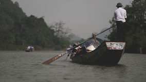 Tourists in boat near Perfume Pagoda  Stock Image