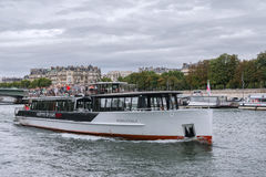 Tourists Boat in Paris Stock Photography