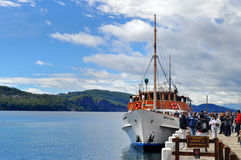 Tourists boat at the pier in Lake Nahuel Huapi Stock Images