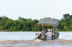 Tourists in boat Rufiji river Royalty Free Stock Photo