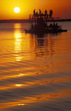 Tourists on a boat at sunset, Botswana. Sunset over river Chobe, which marks the border between Chobe National Park in Botswana (from where the picture was Royalty Free Stock Photo