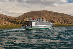 Tourists in the Boat, Titicaca Lake, Peru Royalty Free Stock Photo