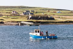 Tourists on boat to the Skellig islands royalty free stock photo