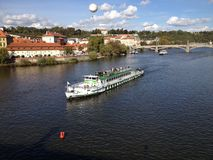Tourists on boat trip on Vltava river Royalty Free Stock Image