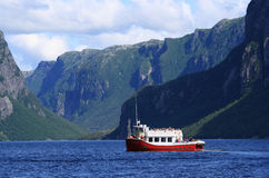 Tourists on Boat at Western Brook Pond Royalty Free Stock Images