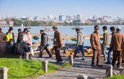 Tourists and boatmen on West Lake coast Stock Photography