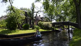 Tourists in boats on the canal of the village of Giethoorn stock video