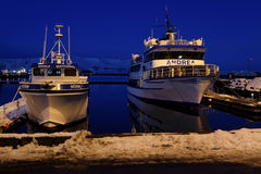 Tourists boats at night in Reykjavik Stock Photos