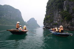 Tourists on boats in Vietnam Royalty Free Stock Image