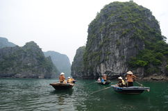 Tourists on boats in Vietnam Royalty Free Stock Photography