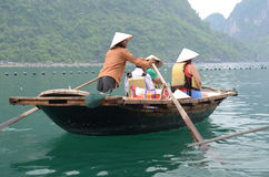 Tourists on boats in Vietnam Royalty Free Stock Photos