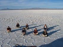 Tourists in the Bolivian desert. Tourists sitting on the salt desert of Uyuni, Bolivia Stock Photography