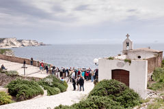 Tourists in Bonifacio, Corsica. Tourists enjoy the view from the cliffs of Bonifacio, Corsica on 6 May 2013 Royalty Free Stock Images