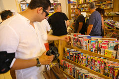 Tourists at bookshop. Tourists walling Bookshop in Hydra island, Greece islands Royalty Free Stock Images