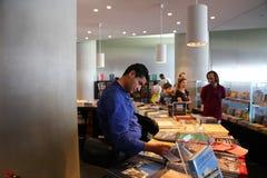 Tourists at bookshop. Tourists walling Bookshop in Hydra island, Greece islands Stock Photos