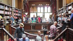 Tourists in bookstore. Tourists in a famous bookstore stock video footage