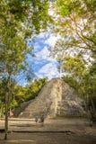 Tourists at the botom of Coba pyramid royalty free stock photography