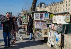 Tourists and Bouquinistes Stock Photography
