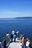 Tourists on bow of Washington State ferry Royalty Free Stock Photos