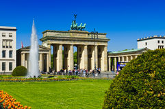 Tourists at the brandenburg gate in berlin. Group of tourists at the brandenburg gate in berlin, germany stock photos