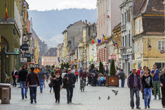 Tourists in Brasov historic center Stock Image