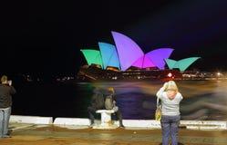 Tourists brave the rain on Opening Night Vivid Sydney Stock Photos