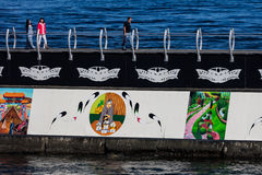 Tourists on the Breakwater. Tourists walk on the Ogden Point Breakwater in Victoria, Canada Royalty Free Stock Photography
