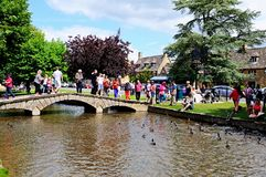 Tourists on bridge, Bourton on the Water. Royalty Free Stock Photo