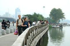 Tourists on the bridge royalty free stock photos