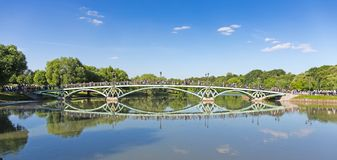 Tourists on the bridge in the museum-reserve Tsaritsyno. MOSCOW, RUSSIA - JUNE 16, 2018: Tourists on the bridge in the museum-reserve Tsaritsyno royalty free stock photos