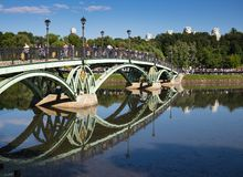 Tourists on the bridge in the  museum-reserve Tsaritsyno. MOSCOW, RUSSIA - JUNE 16, 2018: Tourists on the bridge in the  museum-reserve Tsaritsyno stock photography