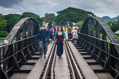 Tourists on the bridge over the river Kwai Stock Images