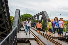 Tourists on the bridge over the river Kwai Stock Photos