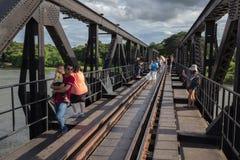 Tourists on the Bridge River Kwai in Kanchanaburi, Thailand Stock Images