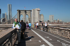 Tourists on Brooklyn Bridge Stock Photo