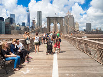 Tourists at the Brooklyn Bridge in New York Royalty Free Stock Images