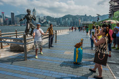 Tourists Bruce Lee statue Avenue of Stars  Kowloon Hong Kong Royalty Free Stock Photo