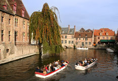 Tourists in Bruges. Tourists in canal boats in Bruges, Belgium stock photography