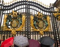Tourists at buckingham palace stock image