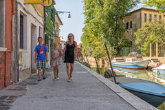 Tourists on Burano island, near Venice, Italy. Royalty Free Stock Photos