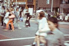 Tourists and business people crossing the street at Harajiku Royalty Free Stock Image