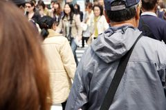 Tourists and business people crossing the street Royalty Free Stock Photos