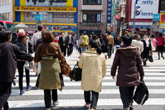 Tourists and business people crossing the street Royalty Free Stock Photography