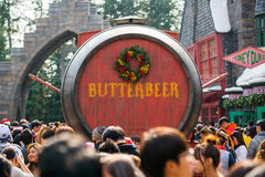 Tourists Butterbeer wood barrel Royalty Free Stock Photo