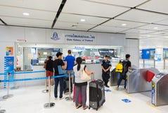 Tourists buy metro tickets at Suvarnabhumi airport in Bangkok Royalty Free Stock Image