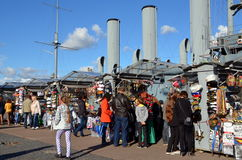 Tourists buy souvenirs at the Cruiser Aurora Royalty Free Stock Photo