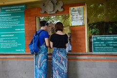 Tourists buy ticket for enter to the temple in Lombok, Indonesia Stock Images