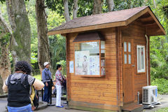 Tourists buy tickets at the box office of grandee Stock Image