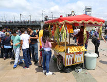 Tourists buying boiled corn from a corn vendor at Eminonu Stock Image